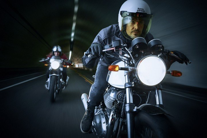 cafe racer royal enfield continental GT 650 motorcycles riding through a tunnel